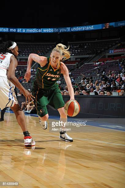Lauren Jackson of the Seattle Storm drives against Kara Braxton of the Detroit Shock at the Palace of Auburn Hills June 4 2008 in Auburn Hills...