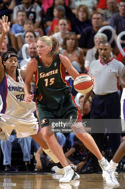Lauren Jackson of the Seattle Storm drives against Tanglea Smith of the Sacramento Monarchs during the WNBA game on June 21 2003 at ARCO Arena in...