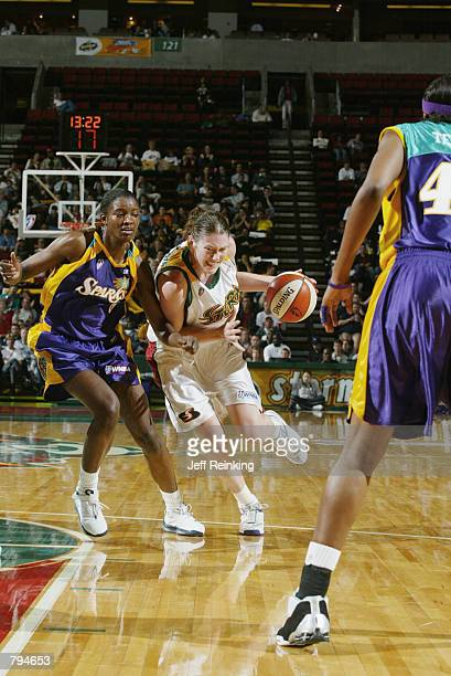 Lauren Jackson of the Seattle Storm drives past DeLisha Milton of the Los Angeles Sparks during the game on June 18 2002 at Key Arena in Seattle...