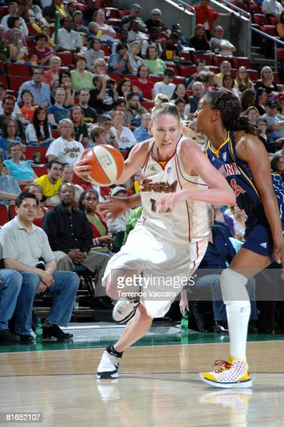 Lauren Jackson of the Seattle Storm drives past the defense of Tamika Catchings of the Indiana Fever on June 20, 2008 at the Key Arena in Seattle,...