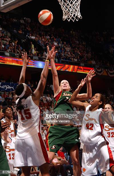 Lauren Jackson of the Seattle Storm goes to the basket against Asjha Jones and Nykesha Sales of the Connecticut Sun on September 12 2004 at the...