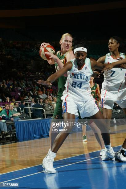 Lauren Jackson of the Seattle Storm grabs a rebound over Amisha Carter of the New York Liberty during the Seattle Storm vs the New York Liberty game...