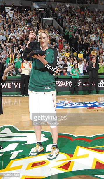 Lauren Jackson of the Seattle Storm holds up the 2010 Most Valuable Player trophy before the game against the Phoenix Mercury in Game One of the 2010...