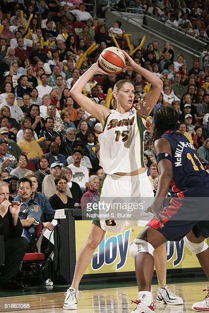 Lauren Jackson of the Seattle Storm looks to make the pass against Taj McWilliamsFranklin of the Connecticut Sun during game Two of the 2004 WNBA...