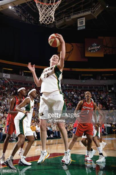 Lauren Jackson of the Seattle Storm recovers the ball as Tina Thompson of the Houston Comets looks on in Game Two of the Western Conference...