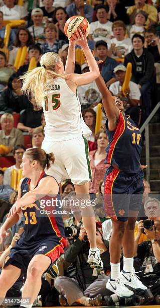 Lauren Jackson of the Seattle Storm shoots against Asjha Jones of the Connecticut Sun during Game three of the WNBA Finals on October 12 2004 at Key...