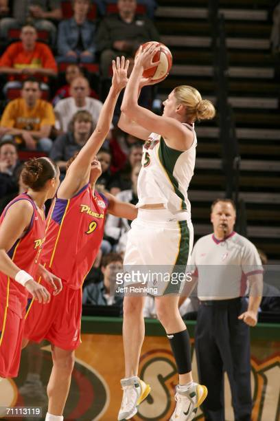 Lauren Jackson of the Seattle Storm shoots against Kamila Vodichkova and Diana Taurasi of the Phoenix Mercury on June 2 2006 at Key Arena in Seattle...