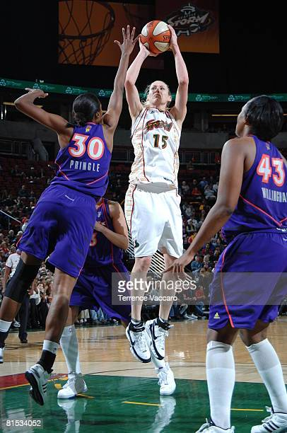 Lauren Jackson of the Seattle Storm shoots against LaToya Pringle and Le'coe Willingham of the Phoenix Mercury at the Key Arena June 11 2008 in...