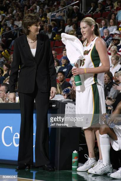 Lauren Jackson of the Seattle Storm talks with Storm coach Anne Donavan during their WNBA game against the Minnesota Lynx May 20 2004 at Key Arena in...