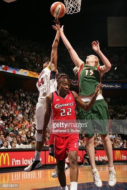 Lauren Jackson of the Western Conference AllStars battles for a rebound against Tamika Catchings of the Eastern Conference AllStars during the 2005...