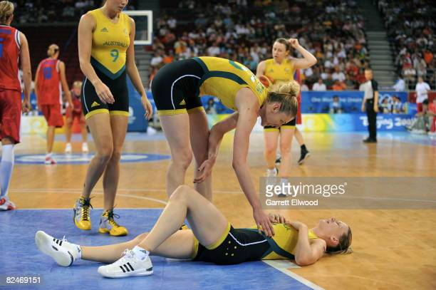 Lauren Jackson tends to Penny Taylor of Australia who is injured against the Czech Republic during day 1 of the women's quaterfinals basketball game...