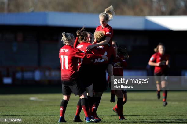 Lauren James of Manchester United celebrates scoring her team's second goal with teammates during the SSE Women's FA Cup Fourth Round match between...