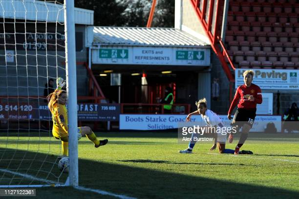 Lauren James of Manchester United scores her team's second goal past Sophie Harris of Brighton Hove Albion during the SSE Women's FA Cup Fourth Round...