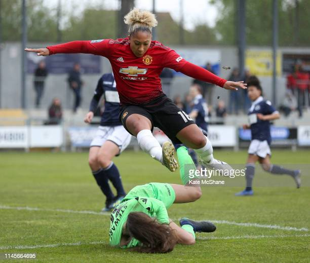 Lauren James of Manchester United Women jumps to avoid Rhiannon Stewart of Millwall Lionesses as she makes a save during the FA Women's Championship...