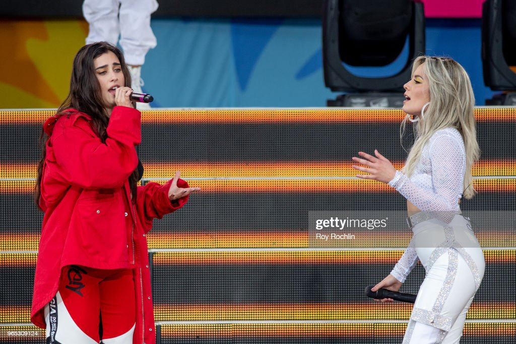 Lauren Jauregui with Halsey on stage as she performs on ABC's 'Good Morning America' at SummerStage at Rumsey Playfield, Central Park on June 1, 2018 in New York City.