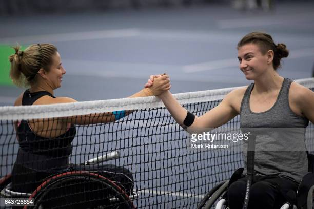 Lauren Jones from Great Britain shakes hands with Lucy Shuker from Great Britain at the end of their match on February 22 2017 in Bolton England