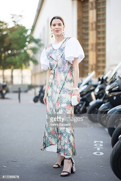 Lauren Kennedi Malpas poses wearing Emilio Pucci shoes after the Sacai show at the Palais de Tokyo during Paris Fashion Week Womenswear SS17 on...