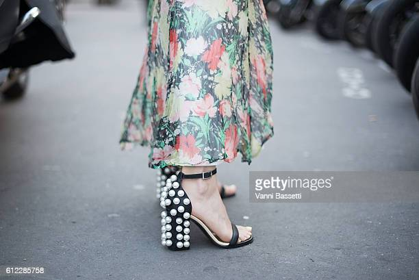 Lauren Kennedy Malpas poses wearing Emilio Pucci shoes after the Sacai show at the Palais de Tokyo during Paris Fashion Week Womenswear SS17 on...