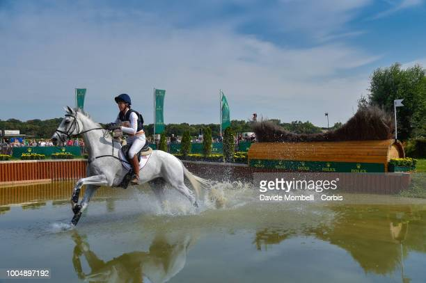 Lauren Kieffer of the United States riding Landmark's Monte Carlo during the obstacle in the water of the Cross Country test DHLPrize in the park of...