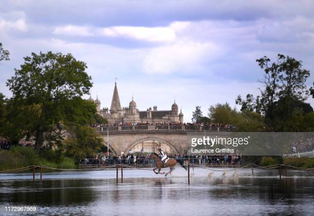 Lauren Kieffer of USA riding Vermiculus rides through the water during the Land Rover Burghley Horse Trials Cross County on September 07, 2019 in...