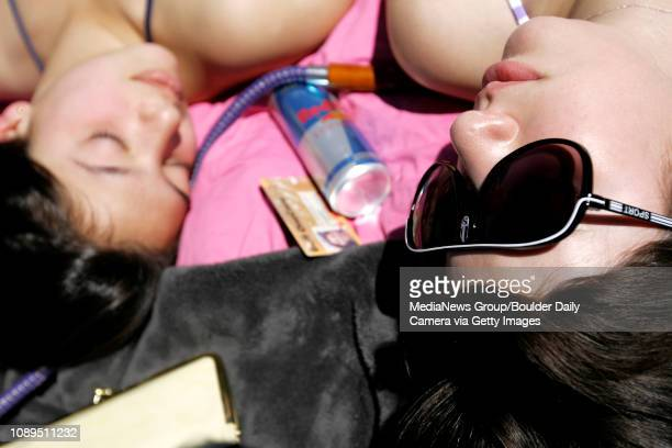Lauren Kolb and Emilia Levin both freshman at the University of Colorado sunbathe on Farrand Field on campus in Boulder on April 14 2008 Temperatures...