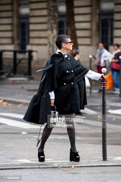 Lauren Kulchinsky Levison wearing a grey checked coat lace tights and black sandals is seen outside the Redemption show during Paris Fashion Week...