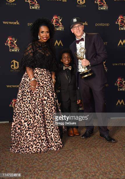 Lauren Lake and David Armour pose with the Daytime Emmy Award for Outstanding Legal/Courtroom Program during the 46th annual Daytime Emmy Awards at...