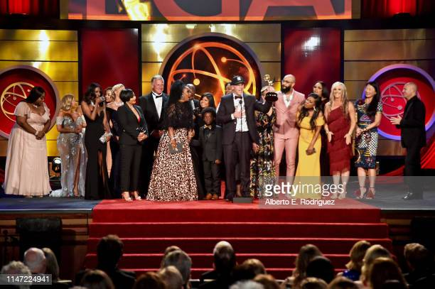 Lauren Lake and David Armour with cast and crew accept the Daytime Emmy Award for Outstanding Legal/Courtroom Program onstage during the 46th annual...