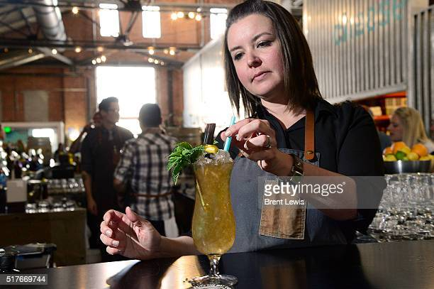 Lauren Lowe garnishes a drink at the RiNo Yacht Club on March 25, 2016 in Westminster, Colorado. Lowe has been selected as one of the top bartenders...