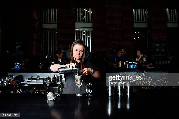 Lauren Lowe mixes up a drink at the RiNo Yacht Club on March 25 2016 in Westminster Colorado Lowe has been selected as one of the top bartenders in...