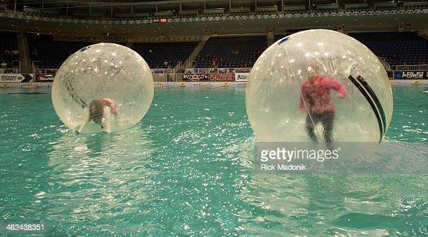TORONTO JANUARY 11 Lauren Maarse of Bowmanville and Emily Orr of Peterborough both try out the Water Ball on the artificial lake in Ricoh Colesium...