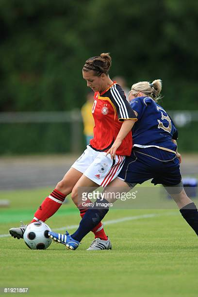 Lauren MacMillan of Scotland and Francesca Weber of Germany fight for the ball during the Women's U19 European Championship match between Scotland...