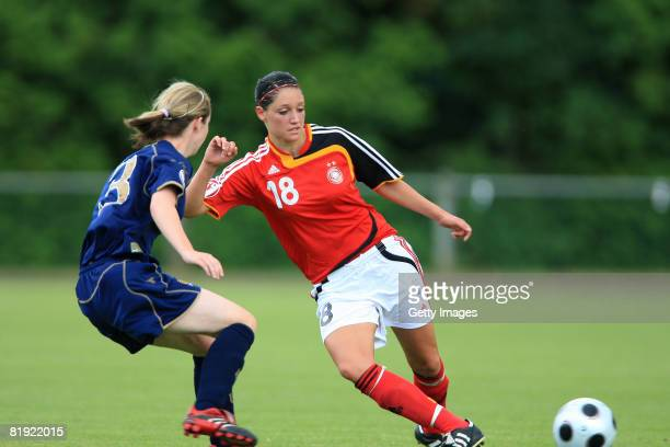 Lauren MacMillan of Scotland and Selina Wagner of Germany fight for the ball during the Women's U19 European Championship match between Scotland and...