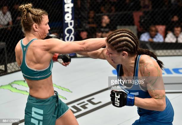 Lauren Murphy and Barb Honchak trade punches in their women's flyweight bout during the TUF Finale event inside Park Theater on December 01 2017 in...