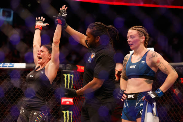 Lauren Murphy celebrates her victory by split-decision over Joanne Calderwood of Scotland during their UFC 263 women's flyweight match at Gila River...
