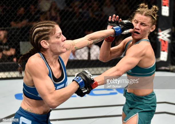 Lauren Murphy punches Barb Honchak in their women's flyweight bout during the TUF Finale event inside Park Theater on December 01 2017 in Las Vegas...