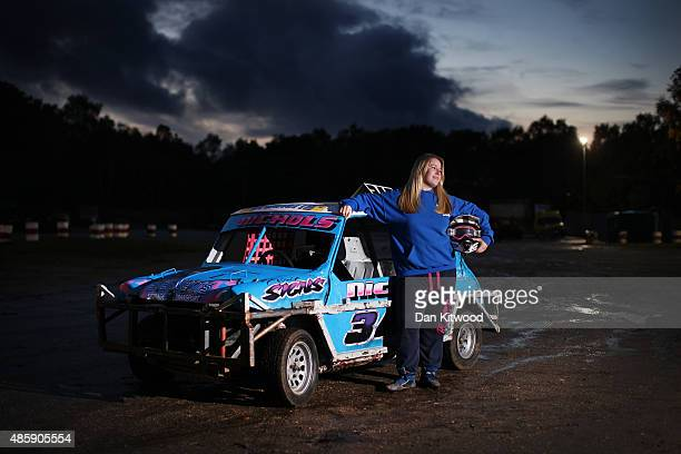 Lauren Nichols from Norwich poses with her Mini ahead of a 'Junior Bangers' meet at Foxhall International Raceway on November 09 in Ipswich England...