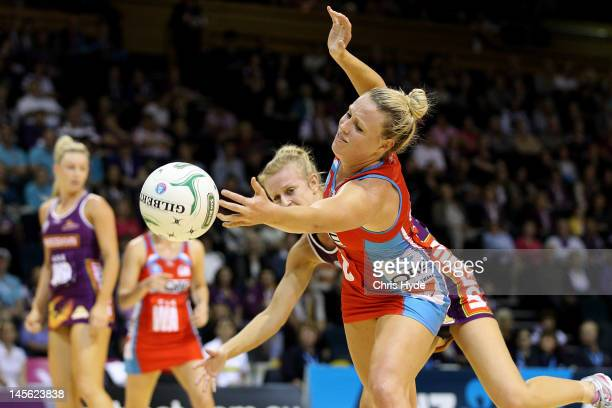 Lauren Nourse of the Firebirds and Kimberlee Green of the Swifts compete for the ball during the round 10 ANZ Championship match between the...