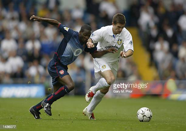 Lauren of Arsenal and Harry Kewell of Leeds United in action during the FA Barclaycard Premiership match between Leeds United and Arsenal at Elland...