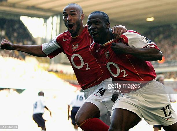 Lauren of Arsenal celebrates with Thierry Henry during the Barclays Premiership match between Tottenham Hotspur and Arsenal at White Hart Lane on...