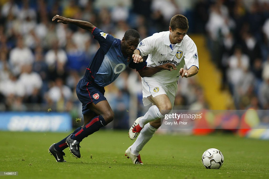 Lauren of Arsenal challenges Harry Kewell of Leeds United for the ball during the FA Barclaycard Premiership match between Leeds United and Arsenal at Elland Road, Leeds, England on September 28, 2002. (Photo by Gary M.Prior/Getty Images) Arsenal won the match 4-1.