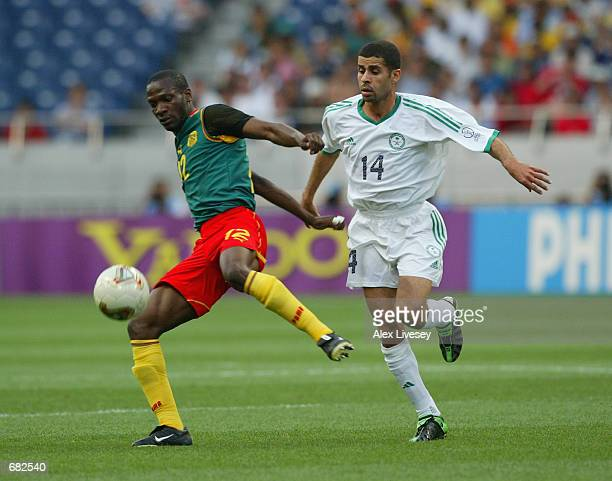 Lauren of Cameroon reaches the ball ahead of Abdulaziz al Khathran of Saudi Arabia during the FIFA World Cup Finals 2002 Group E match played at the...