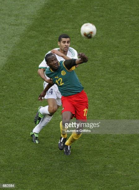 Lauren of Cameroon wins the ball ahead of Abdulaziz al Khathran of Saudi Arabia during the FIFA World Cup Finals 2002 Group E match played at the...