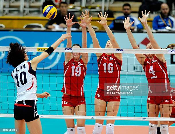 Lauren O'Reilly Jennifer Hinze and Tammy Louise Mahon of Canada try to block the ball from Kim YeonKoung of South Korea during their first round...