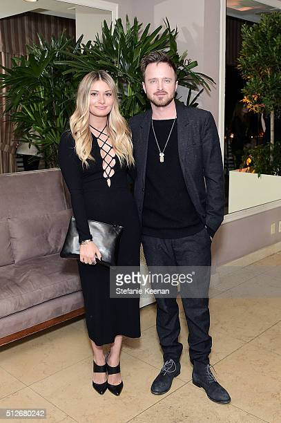 Lauren Parsekian and Aaron Paul attend an intimate dinner celebrating Chopard's Journey to Sustainable Luxury hosted by Colin Livia Firth and...