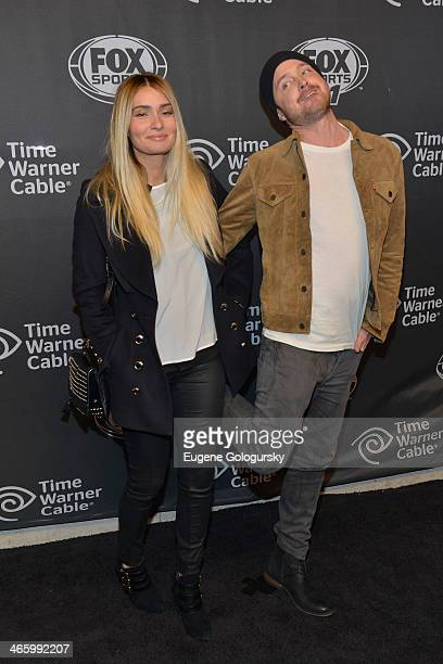 Lauren Parsekian and Aaron Paul attend Time Warner Cable Studios Presents FOX Sports 1 Thursday Night Super Bash on January 30, 2014 in New York City.