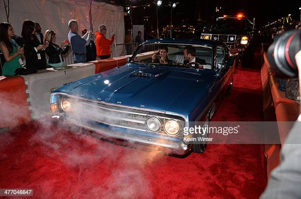 """Lauren Parsekian and actor Aaron Paul arrive at the premiere of DreamWorks Pictures' """"Need For Speed"""" at TCL Chinese Theatre on March 6, 2014 in..."""