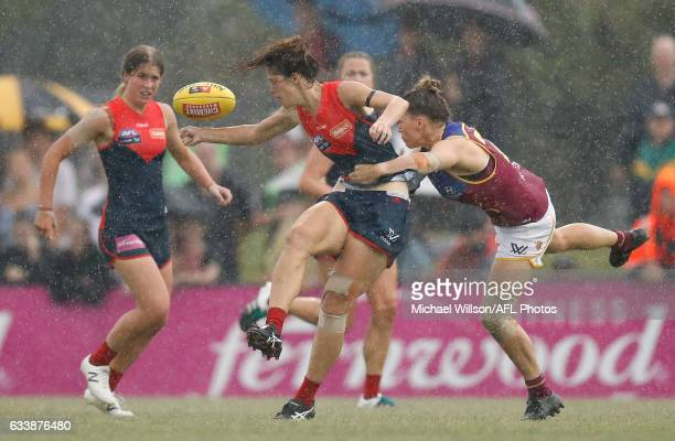 Lauren Pearce of the Demons is tackled by Brittany Gibson of the Lions during the 2017 AFLW Round 01 match between the Melbourne Demons and the...