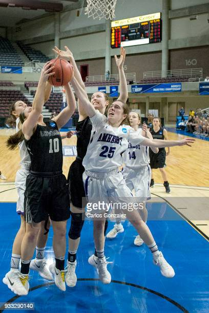 Lauren Petit of Bowdoin and Hannah Fox of Amherst College fought for a rebound during the Division III Women's Basketball Championship held at the...