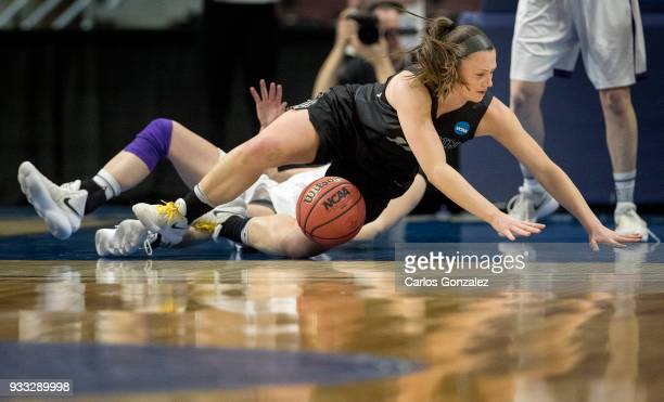 Lauren Petit of Bowdoin fell to the floor going for a loose ball during the Division III Women's Basketball Championship held at the Mayo Civic...
